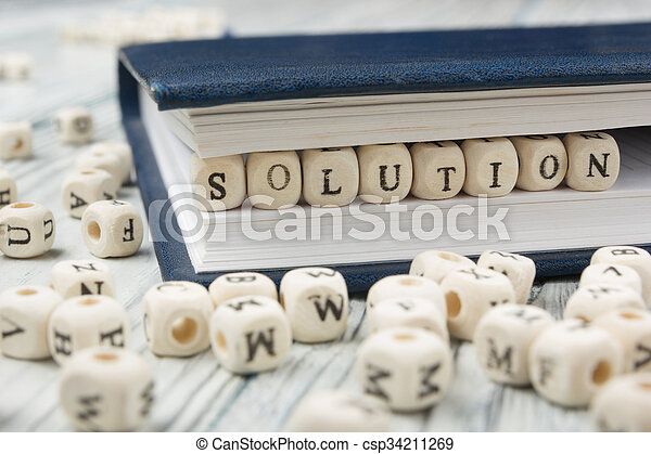 Wood blocks with letters spelling Solution . Wooden ABC. - csp34211269