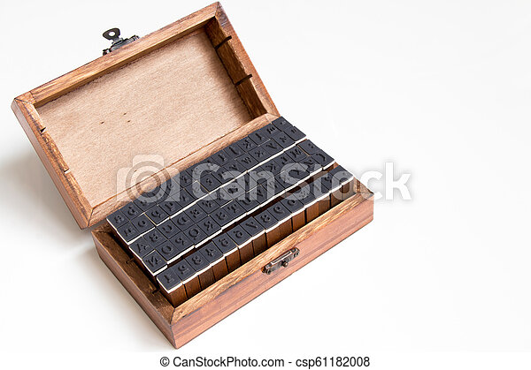 Wood box contain english alphabet and number rubber stamp on white background - csp61182008