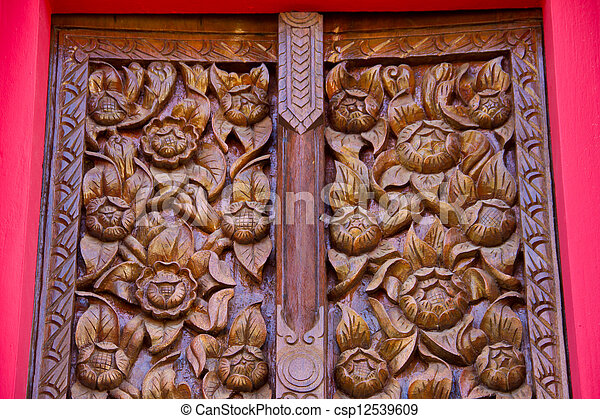 Wood carving decorated at windows of the temple, hand made by Th - csp12539609