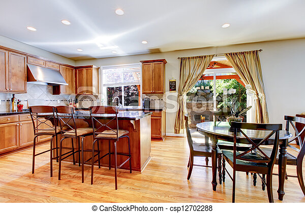 Wood classic large kitchen with granite island. - csp12702288