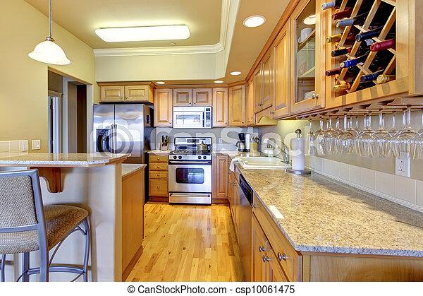 Wood golden kitchen in luxury apartment. - csp10061475