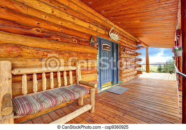 Wood log cabinet porch with entrance and bench. - csp9360925