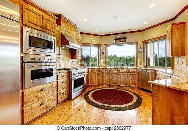 Wood luxury home kitchen interior. New Farm American home. - csp12862977