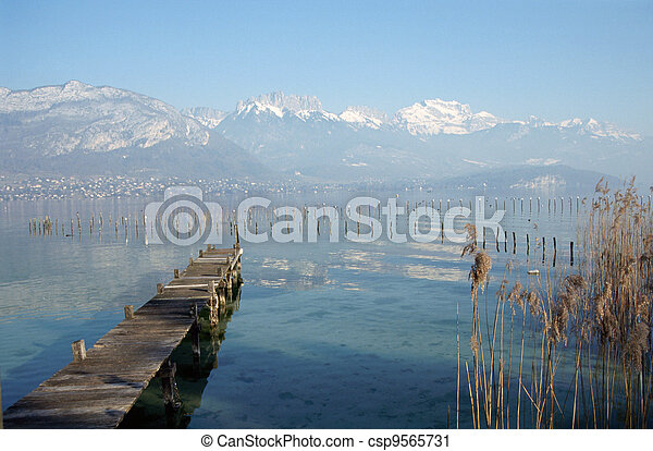 Wood pontoon and mountains on Annecy lake, France - csp9565731