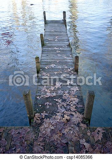 Wood pontoon, water, on Annecy lake, France. - csp14085366