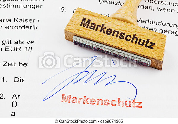 wood stamp on the document: brand protection - csp9674365