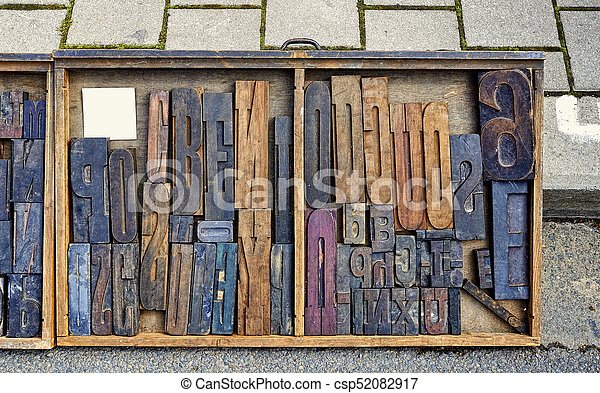 Wood Type Mixture in a desk drawer - csp52082917