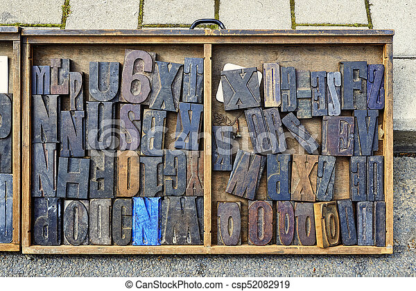 Wood Type Mixture in a desk drawer - csp52082919