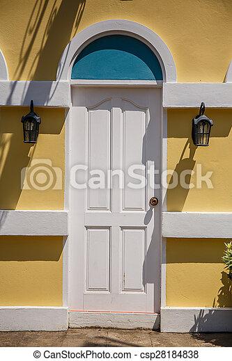 wood white door on brick wall - csp28184838