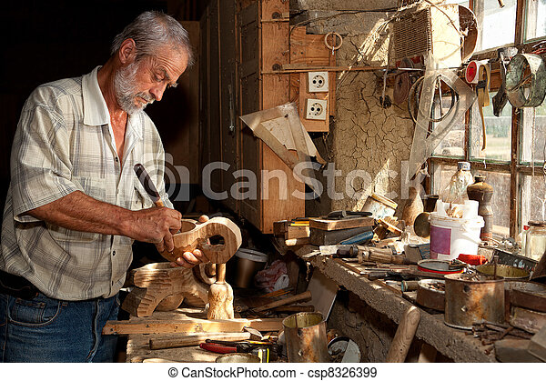 Wood worker in old shed - csp8326399