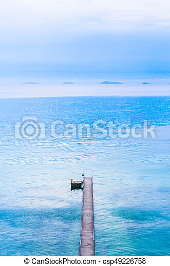 Woodden pier bridge, wooden jetty stretches out into the sea, Samui Island, Thailand - csp49226758