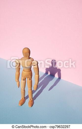 Woodem man figure - csp79632297