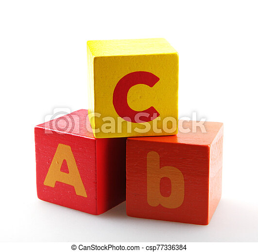 Wooden alphabet blocks isolated on white background - csp77336384