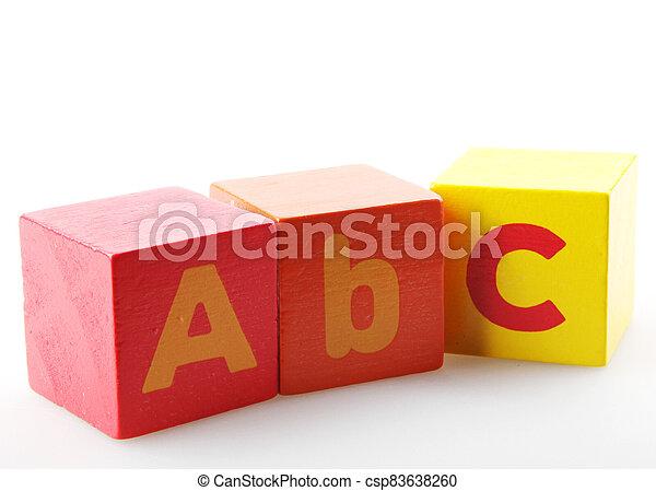 Wooden alphabet blocks isolated on white background - csp83638260