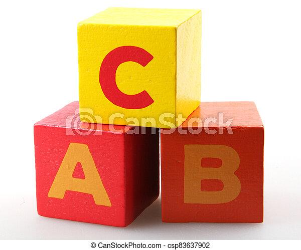 Wooden alphabet blocks isolated on white background - csp83637902