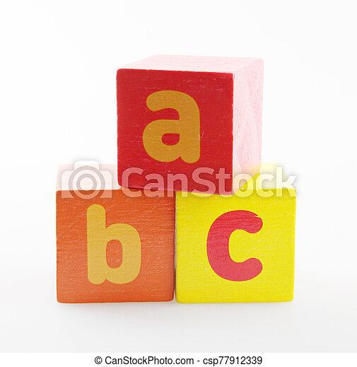 Wooden Alphabet Blocks Isolated On White Background - csp77912339