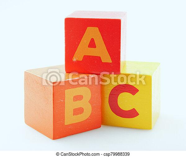 Wooden Alphabet Blocks Isolated On White Background - csp79988339