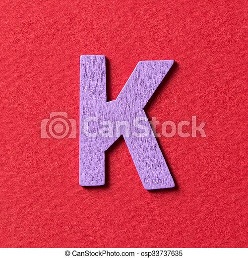 Wooden alphabet K in capital letter - csp33737635