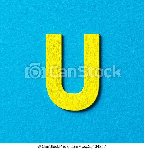 Wooden alphabet U in capital letter - csp35434247