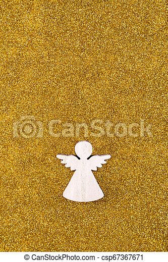 Wooden angel on golden glitter background - csp67367671