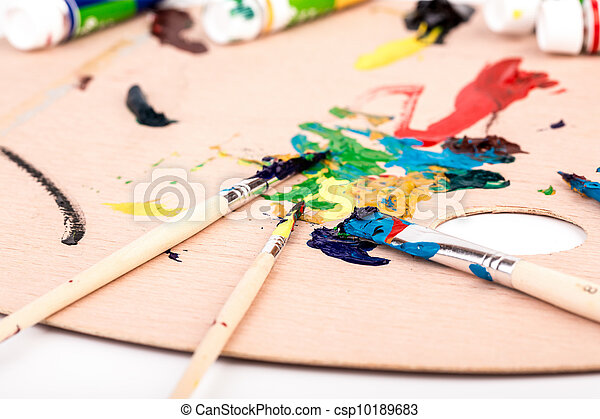 Wooden art palette with paint  brush on white background - csp10189683