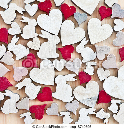 Wooden background with hearts and easter bunnies - csp18740696