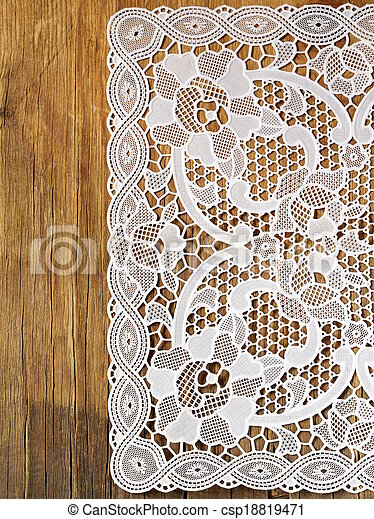 wooden background with lace napkin - csp18819471