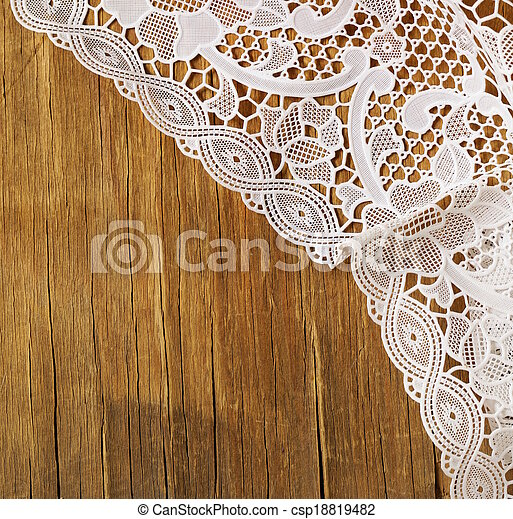 wooden background with lace napkin - csp18819482