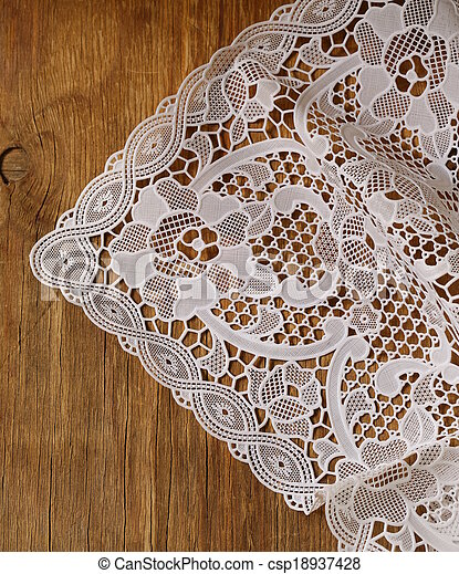 wooden background with lace napkin - csp18937428