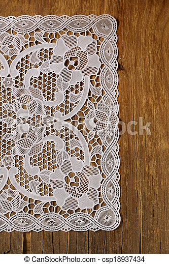 wooden background with lace napkin - csp18937434