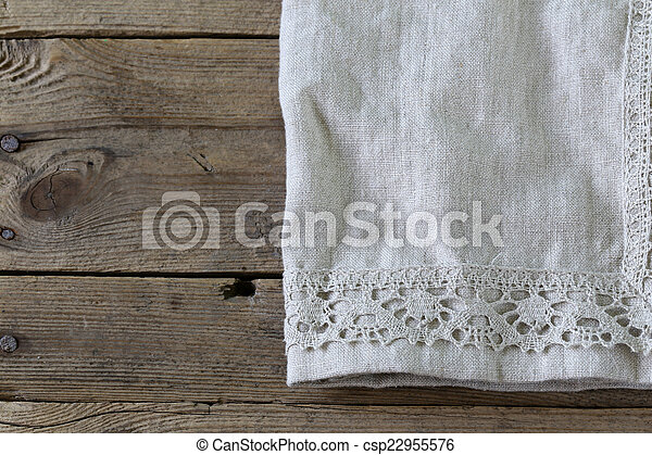 wooden background with napkin - csp22955576