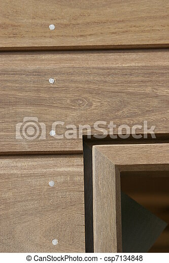Wooden bardage on a new house - csp7134848