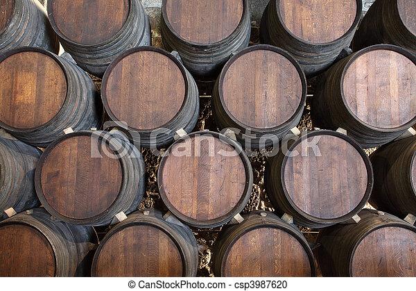 Wooden barrels in a wine cellar - csp3987620