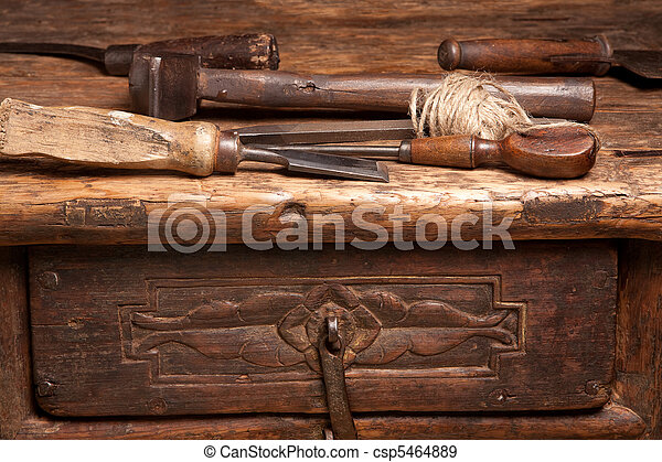 Wooden bench and rusty tools - csp5464889