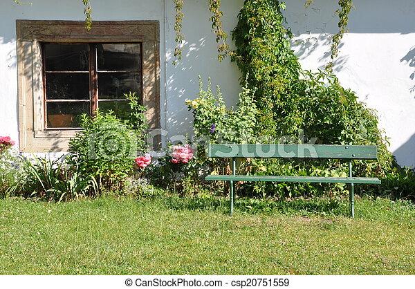 Wooden bench in the garden - csp20751559