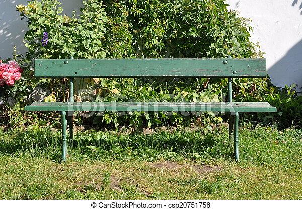 Wooden bench in the garden - csp20751758