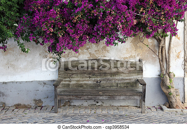 Wooden bench in the old town of Faro, Algarve Portugal - csp3958534
