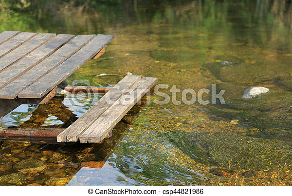 Wooden bench on the lake, Thailand - csp44821986