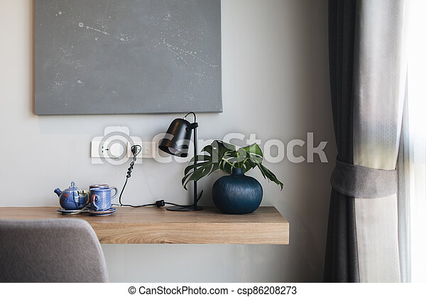 Wooden black and grey modern table and desk in bedroom - csp86208273