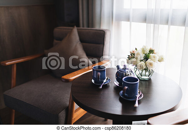 Wooden black and grey modern table and desk in bedroom - csp86208180