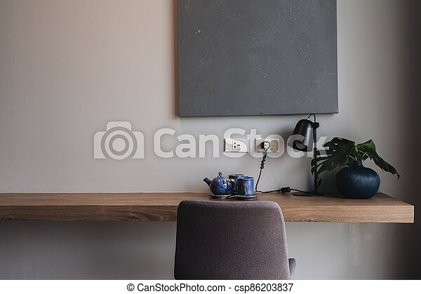 Wooden black and grey modern table and desk in bedroom - csp86203837