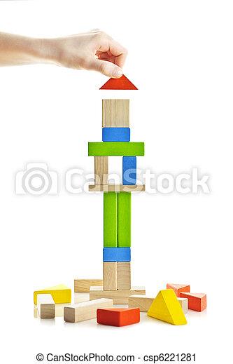 Wooden block tower under construction - csp6221281