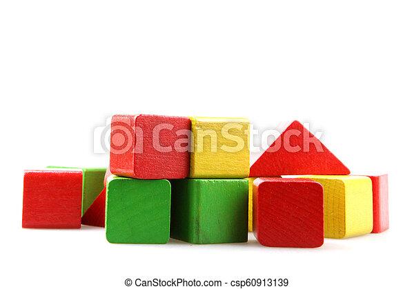 Wooden blocks isolated on white background - csp60913139