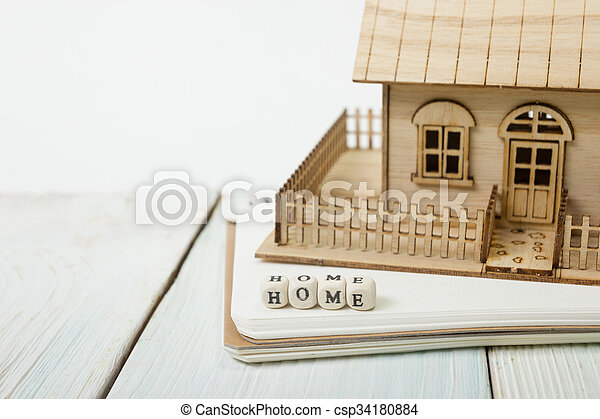 Wooden blocks spelling the word Home - csp34180884