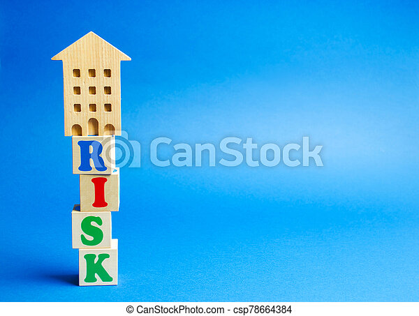 Wooden blocks with the word Risk and a miniature house. Real estate investment risk. Risky investments. Loss of property for non-payment. Debts. Mortgage tax. Fraudulent schemes. - csp78664384