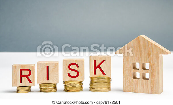 Wooden blocks with the word Risk and coins with a house. The concept of risk, loss of real estate. Property insurance. Loans secured by home, apartment. Financial risks, litigation. Debt growth - csp76172501