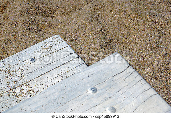 wooden board on the beach - csp45899913