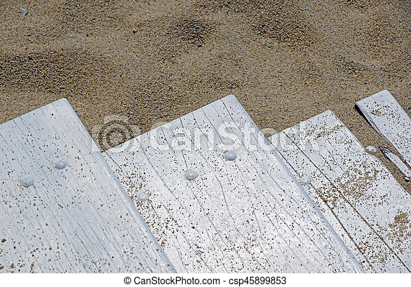 wooden board on the beach - csp45899853
