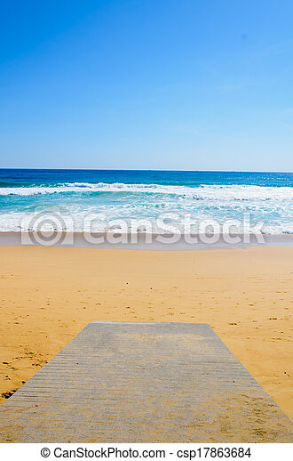 wooden Boardwalk on the beach and tropical sea - csp17863684