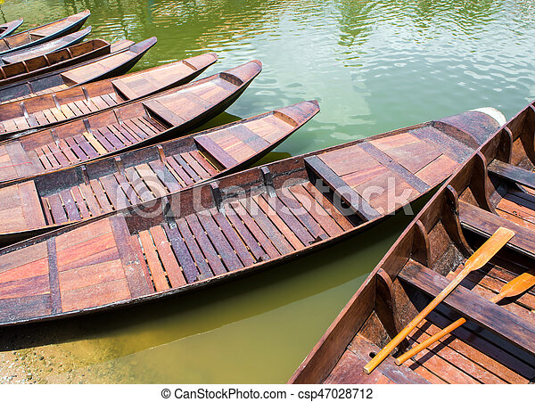 Wooden boat float in lake - csp47028712